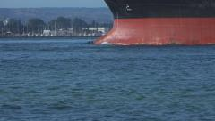 Ships bow ploughing through sea water Stock Footage