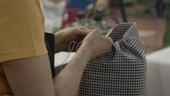 Stock Video Footage of Seamstress sewing cushion for sofa