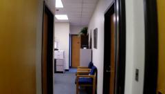 Walking down  narrow office corridor 2 Stock Footage