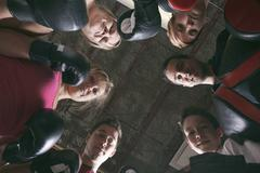 Boxing aerobox women group with personal trainer man at fitness Stock Photos