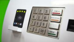 Human hand enter pin code on ATM Stock Footage