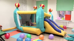 small children frolic on a holiday birthday by jumping on a trampoline - stock footage