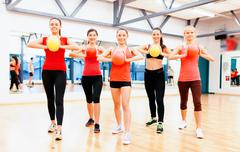 Stock Photo of group of people working out with stability balls