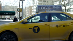 Taxi cab turns corner of 5th Ave and 8th Street in 4K, Manhattan, NYC Stock Footage