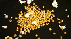 Popcorn cooking in a pan Stock Footage