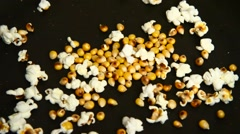 Pop corn cooking in a black pan Stock Footage