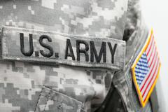 USA flag and US Army patch on solder's uniform Stock Photos