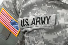US Army and flag patch on solder's uniform - stock photo
