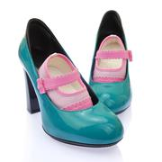 Baby shoes on mom's high heels Stock Photos