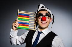 Funny clown with abacus in accounting concept Stock Photos