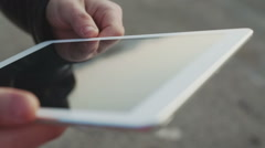 Close up of man hand touching digital tablet Stock Footage