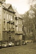 Old dwelling houses in Lviv, Ukraine, sepia - stock photo