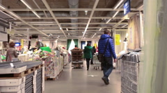 Customers walk through the Ikea stands in showroom. Ikea marketplace interior Stock Footage