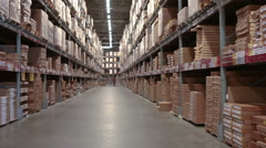 Finished products warehouse with multi level racks, camera moving - stock footage