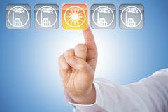 Finger Activating Yellow Solar Energy Icon On Blue Stock Photos