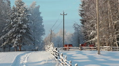 Countryside landscape with snowy horse paddock and road to village, winter time Stock Footage