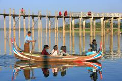 Group of tourists in a boat near U Bein Bridge, Amarapura, Myanmar Stock Photos