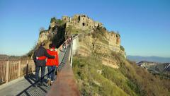 People walking on the bridge to Civita di Bagnoregio Stock Footage