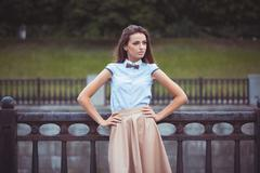 Young beautiful, elegantly dressed woman Stock Photos