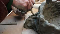 Man is shaping a clay sculpture Stock Footage
