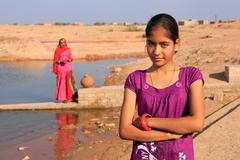 Local girl standing near water reservoir, Khichan village, India Stock Photos