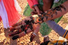 Local girl showing henna painting, Khichan village, India - stock photo