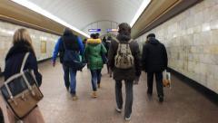 People go to the underground passage. Stock Footage