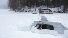 Lane from forest island to square ice-hole for dipping on the lake shore, winter Stock Footage