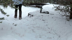 Woman wearing grey felt boots going pathway of rural yard at winter season Stock Footage