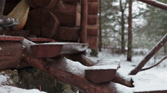 Woman wearing felt boots going down the timber stairs, winter season. Camera mov Stock Footage