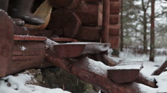 Woman going down the timber stairs in felt boots, winter season. Camera moving Stock Footage