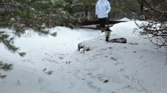 Woman wearing in modern jacket and old-fasioned felt boots walking on snow Stock Footage
