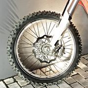Cross motorbike wheel - stock photo