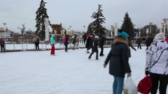 Main city skating rink is in Moscow VDNKh area near central pavilion building Stock Footage