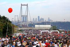 ISTANBUL - OCTOBER 17: Thousands of people make their way through Bosporus su Stock Photos
