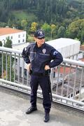 Policeman standing on the bridge - stock photo