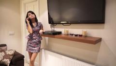 Asian Women on phone standing Modern House HDTVT Stock Footage