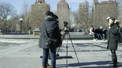 film student documentary Washington Square Park arch cold winter snow 4K NYC - stock footage