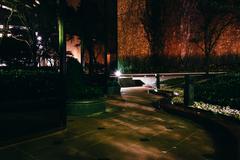 Dark walkway at night, in Dallas, Texas. Kuvituskuvat