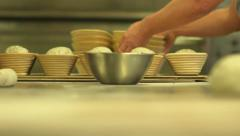 Bakery - several loaves being taken to oven and dough kneaded Stock Footage