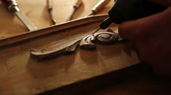 Close up of carpenter carving wood with engraver tool - stock footage