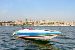 Colorful race boat in berth - stock photo