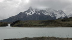 Wide Shot of the Paine Massif over an alpine lake Stock Footage