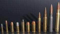 Line up of different caliber ammo, ammunition display Stock Footage