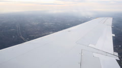 Flying in airplane - plane dips toward ground Stock Footage