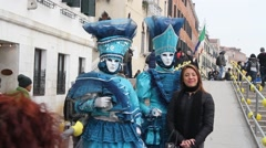 Costumed peopel posing for tourists   During The Carnival In Venice full hd Stock Footage