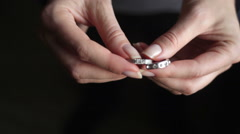 Hands of girl hold two rings Stock Footage