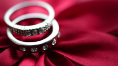 Wedding rings on a red bow Stock Footage
