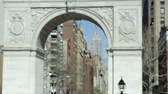 People hanging out Washington Square Park Arch Empire State Building 4K NYC Stock Footage