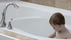 Toddler taking a bath in a large bath tub Stock Footage